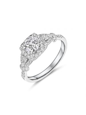 18ct white gold halo style diamond ring with diamonds on each shoulder