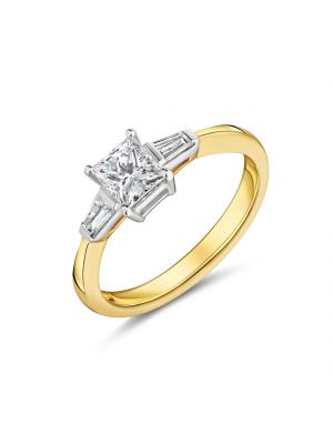18ct yellow gold princess cut diamond with tapered baguette on each shoulder ring