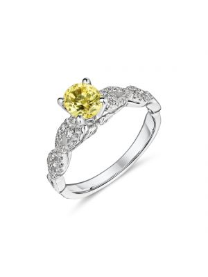 18ct white gold yellow oval sapphire ring with diamond set shoulders