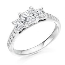 18ct white gold three stone princess cut diamond ring with round brilliant diamond shoulder