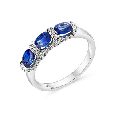 18ct white gold three stone sapphire ring with diamond surround