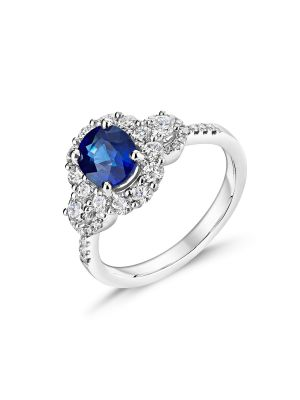 18ct white gold Oval sapphire ring with diamond surround and diamonds down each shoulder